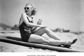 1936:  Legendary American dancer and actress Ginger Rogers (1911 - 1995) rubs sun lotion onto her legs before a stint of sunbathing.  (Photo via John Kobal Foundation/Getty Images)